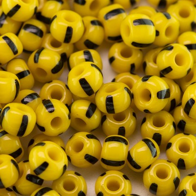 Preciosa Czech glass seed bead 5/0 Opaque yellow with Black Stripe