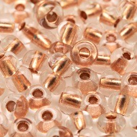 Preciosa Czech glass seed bead 5/0 Clear glass Copper Lined